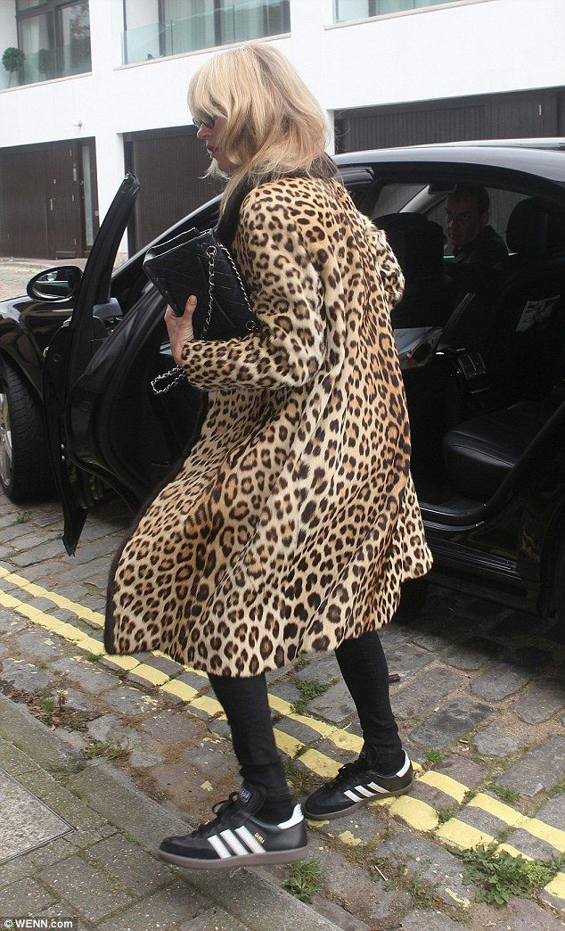 Low-key look: The beauty kept on her glamorous pelt, but added a comfy pair of skinny jeans and trainers