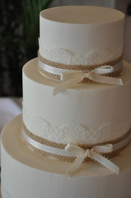 this is so beautiful cos it's so so simple. I like how the lace ties into your dress, the burlap ties into the table design etc. you could make the cake a bit more detailed by doing that pattern of the lace in icing instead of having lace perhaps?