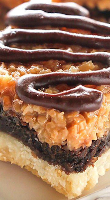 Samoa Brownie Bars.... shortbread crust topped with a brownie layer and caramel coconut.
