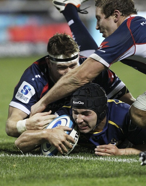 Colby Faingaa of the Brumbies scores a try during the round 17 Super Rugby match between the Brumbies and the Rebels at Canberra Stadium on June 7, 2013 in Canberra, Australia.