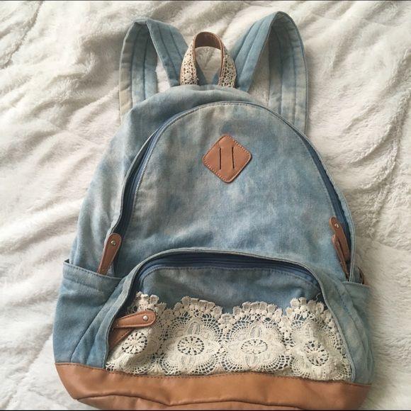 Denim and Lace Bookbag Hobo chic festival style backpack. Slight rust staining on the adjustable straps from metal adjusters. Average size Bookbag - fits text books. Divider pocket inside. Kind of an acid washed Jean print Boho Bags Backpacks