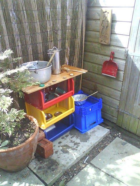 outdoor play kitchen - love the bins!