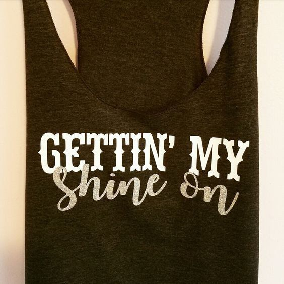 Gettin' my SHINE ON printed on a triblend, racerback tank top. These tanks are a mix of cotton and poly, making them super soft and light. *Glitter colors available: Silver, Gold, Red, Teal, Pink, Dar