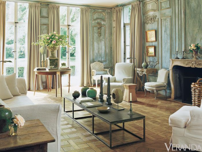 Exquisite eighteenth-century boiserie anchors a regal living room; a straightforward coffee table and simple fabrics give it an easeful, quintessentially Belgian appeal.   - Veranda.com