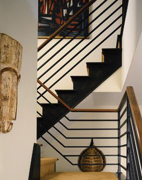 Stairs-- this looks great.  Railing without verticals at bend, black steel, wood rail at top, black side of stair.