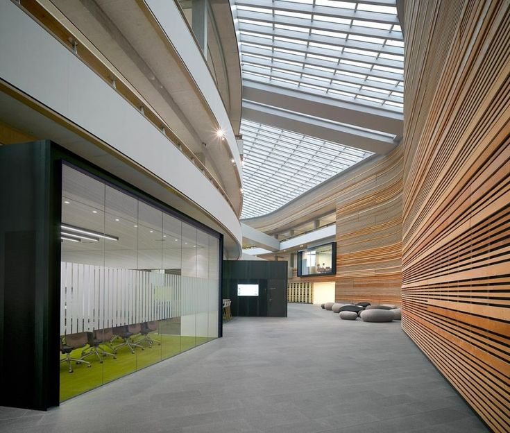 Very modern approach with mixture of 'real' materials. This is the BP corporate office. Good use of natural light and curved walls to achieve sense of flow.