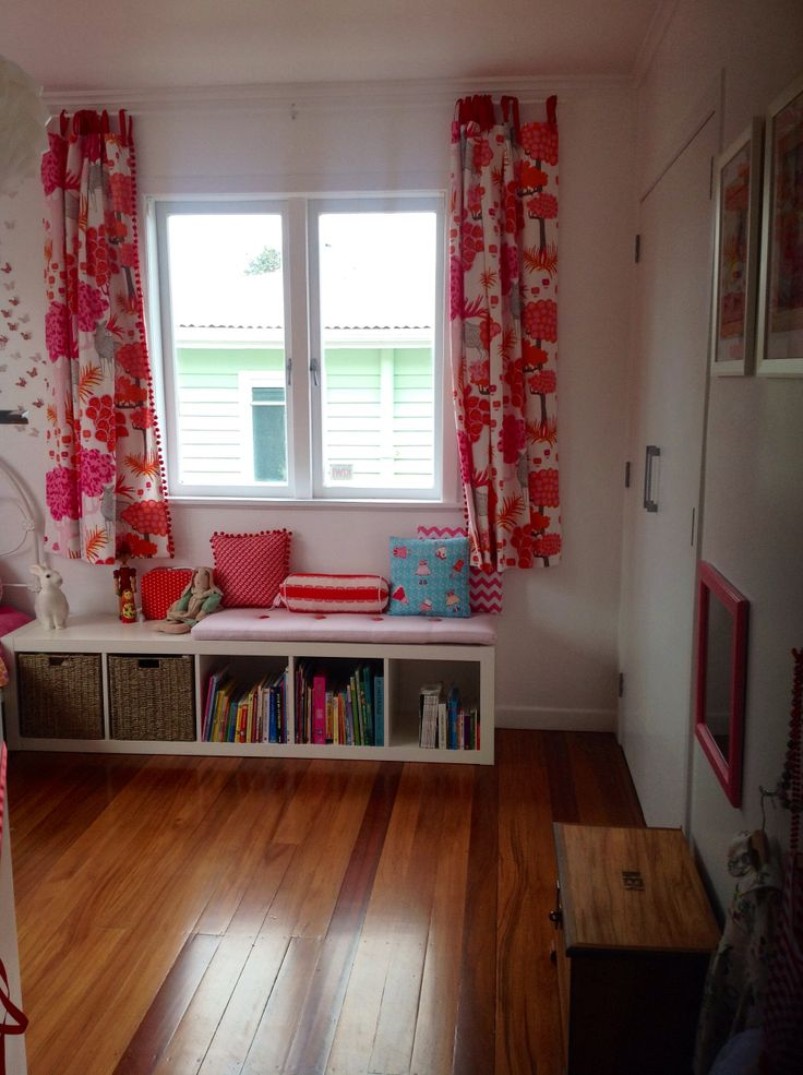 Reading corner, home made cushions to give retro look with soft orange, red, and pinks
