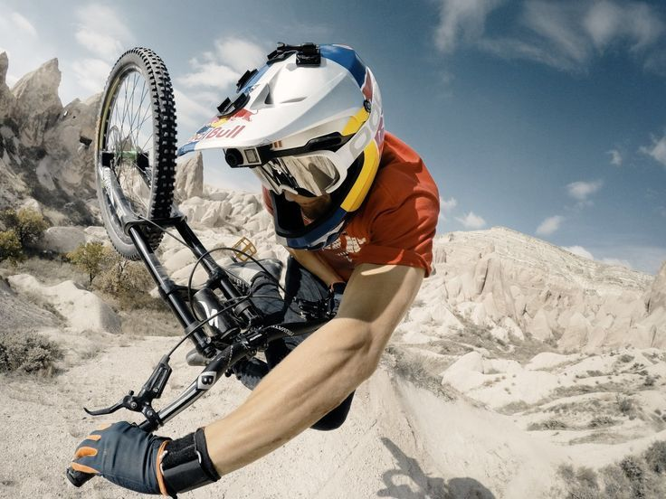 Awesome red bull rider doing a huge table at what looks like red bull Rampage. Awesome Downhill Mountain biking tricks. http://www.tresna.co.uk