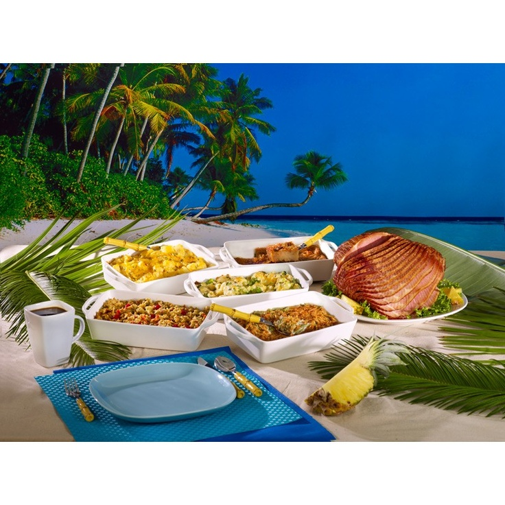 The Margaritaville® Half Honey Glazed Ham with Brown Sugar Pineapple Sauce Complete Meal brings the tropics to your holiday! Each premium 7-9 pound ham is slow smoked over hickory chips for 24 hours, then glazed with a unique blend of honey, brown sugar and traditional spices, fire torched to perfection, then spiral cut for easy serving. You will also receive cornbread & cranberry dressing, broccoli cheese casserole, green bean casserole, potatoes au gratin, and bread pudding. A complete…