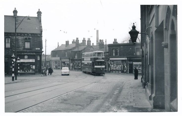 https://flic.kr/p/ZvYVpu | Kirkstall Lights Junction. 1950s. | Looking towards the City.....Kirkstall Lane and Headingley to the left....Bridge Rd and the Star & Garter to the right.