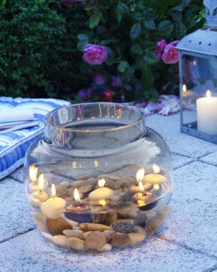 good ideaDecor, Lights, Ideas, Floating Candles, Rivers Rocks, Candles Centerpieces, Outdoor Tables, Pools Parties, Goldfish Bowls