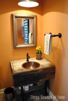 Vintage cabinet turned bathroom vanity. Plumbing fixtures used for legs and towel bar.  From Blog - Three Scoops of Love.