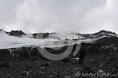 Man climbs up the second highest peak in Georgia.