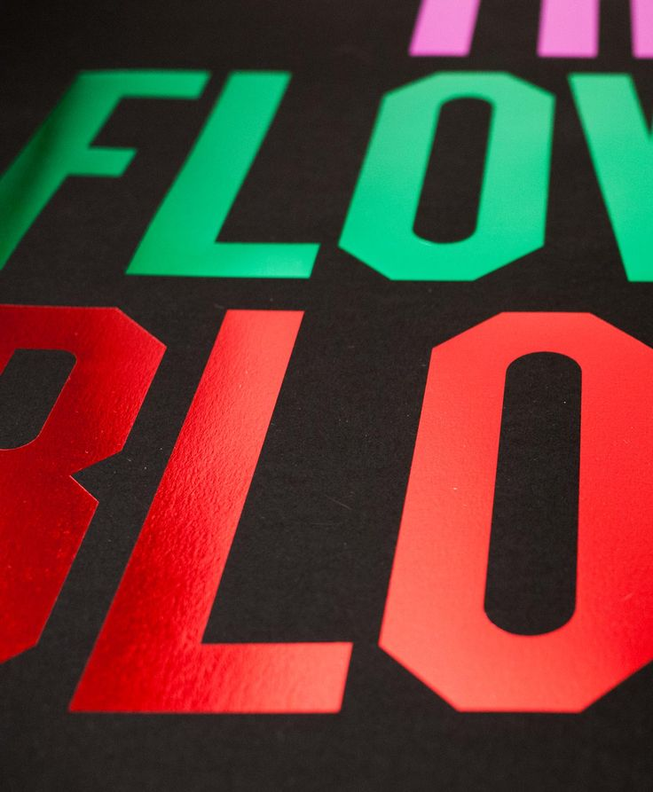 Anthony Burrill's 'Let the Flower Bloom' as seen in Tom and David's living area. We love the four different colours of hot foiling! #lifephilosophy #nellyathome #interiors #art #AnthonyBurrill  Find it here: http://www.nellyduff.com/gallery/anthony-burrill/let-the-flower-bloom-foil-black