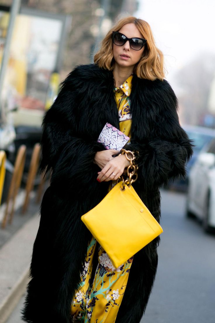Show-goers dress for transitional weather with colorful, fuzzy scarves.