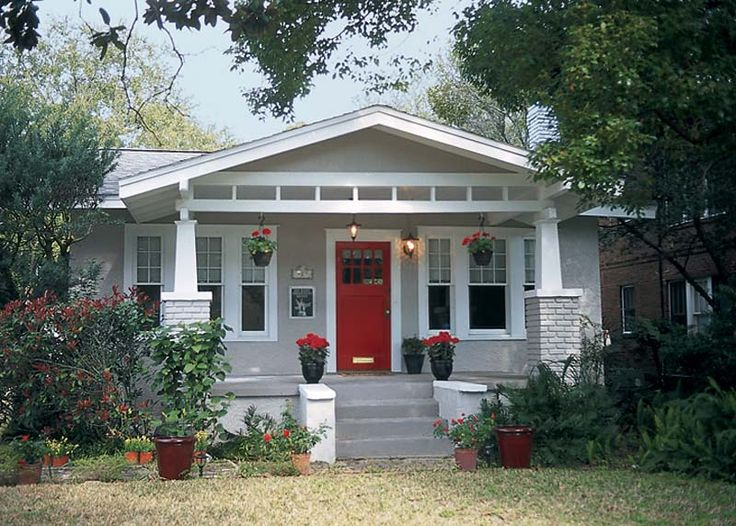Light gray house with red door.