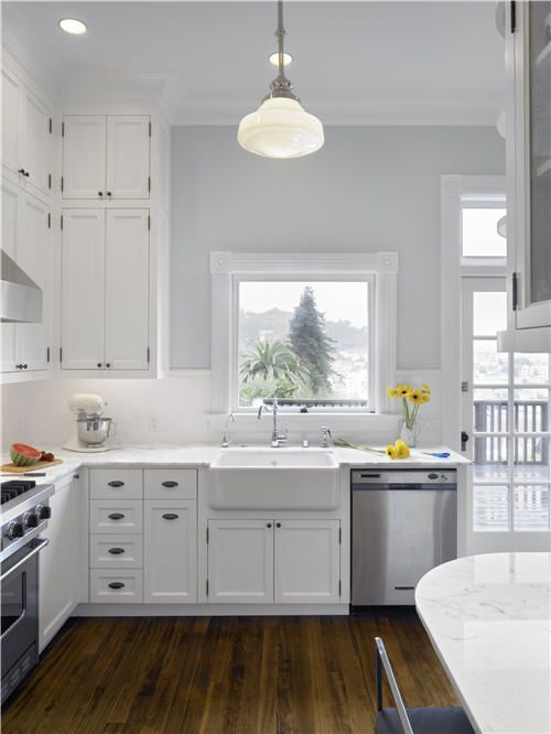 White cabinets kitchen grey walls bright kitchen for Grey and white kitchen cabinets