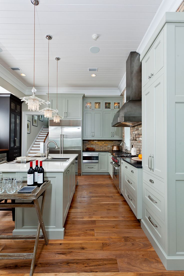 very pretty very functional kitchen with interesting brick backsplash the cabinets are painted - Coastal Kitchen Ideas