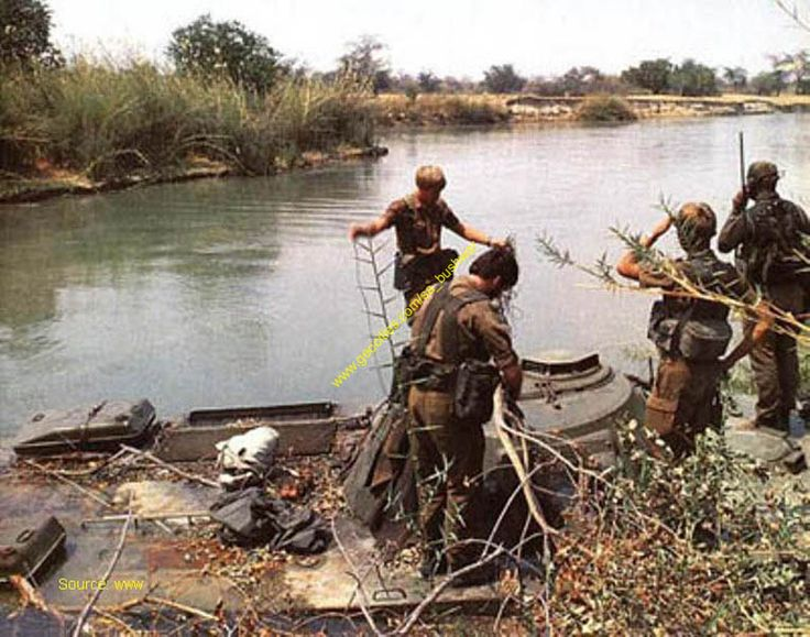 "South African troops on the Quito river at a place called Mapupa. It became an intermediate repairs station for the amazing Rattel Combat Vehicle. The ""Tiffies"" were amazing at keep these vehicles going under such terrible working conditions"