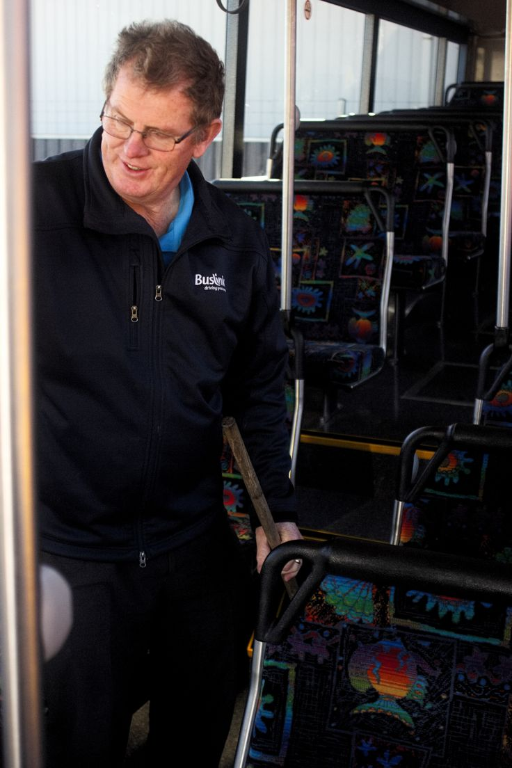 FINAL 7: I chose this photo as it's a casual photo of my dad as he cleans the bus after a bus run, I like the framing of dad between two poles on the bus