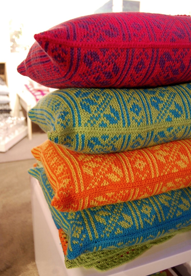Love, love these bright colors and bold patterns!   Beautiful knit Norwegian pillows