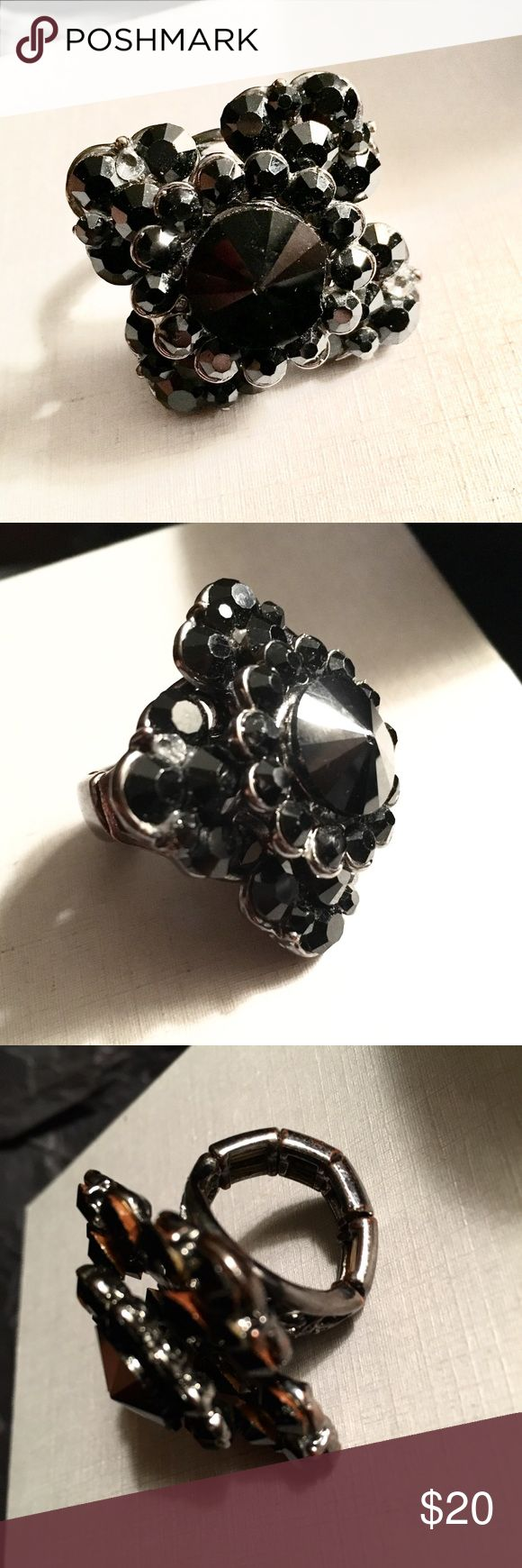 RING- adjustable black rhinestone statement ring Badass black rhinestone ring. It's band has beaded elastic to fit any size finger. It's so fun and will earn you tons of compliments with every wear! Jewelry Rings