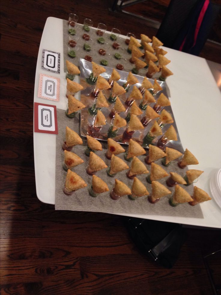 Samosas in shot glasses filled with chutney. I did this as an appetizer for a Diwali party.