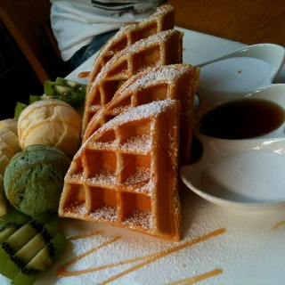 Waffle with green tea ice cream and maple syrup