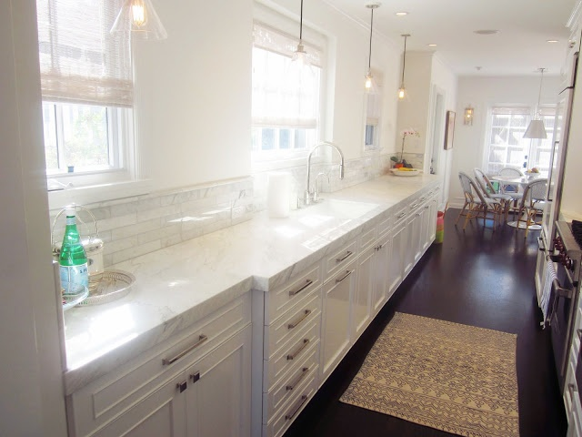 White on white galley kitchen honed marble counters for Galley kitchen with breakfast nook