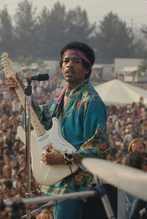 Jimi Hendrix performing at Woodstock, a massive music festival held in August 1969. It is regarded as one of the most pivotal events in the history of popular music.