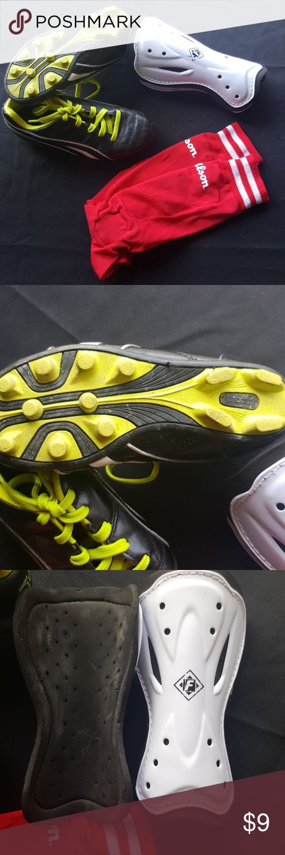 Boys Soccer set Size 2 black and neon yellow ProCat by Puma soccer shoes, gently worn.  Also included are a set of shin guards and a pair of red Wilson soccer socks with ankle pads. They were worn for a soccer season by my son so they do have some wear however they have tons of life left!! Puma Shoes