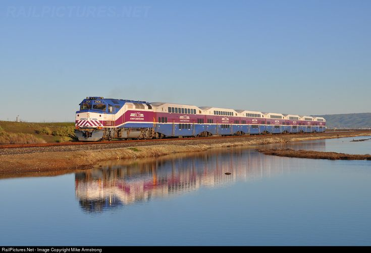 ACE runs along a causeway in Alviso, CA: ACEX 3106 Altamont Commuter Express MPI F40PH-3C at Alviso, California by Mike Armstrong
