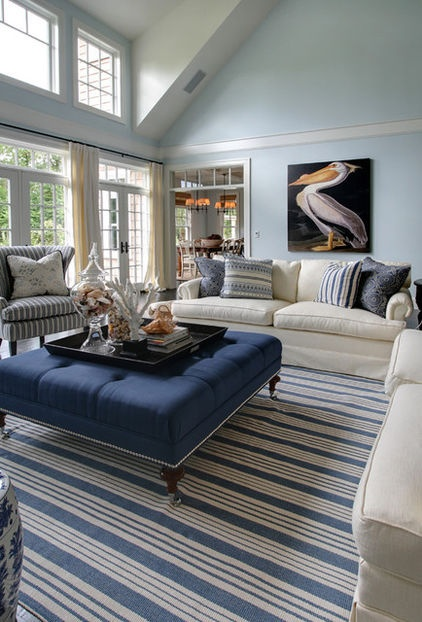 Large navy ottoman as base for tray of accessories - traditional living room by Garrison Hullinger Interior Design Inc.