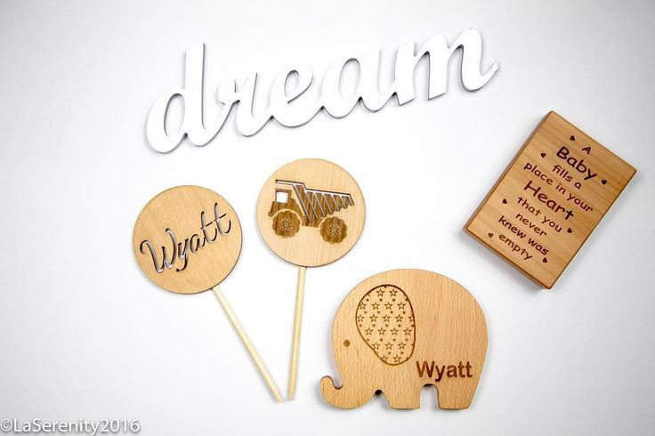 Custom made for a special little boy. Wooden Cake Toppers and one of our personalised Elephants made from solid European Beech wood.