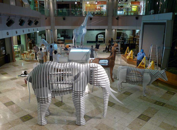 laser-cut cardboard animals