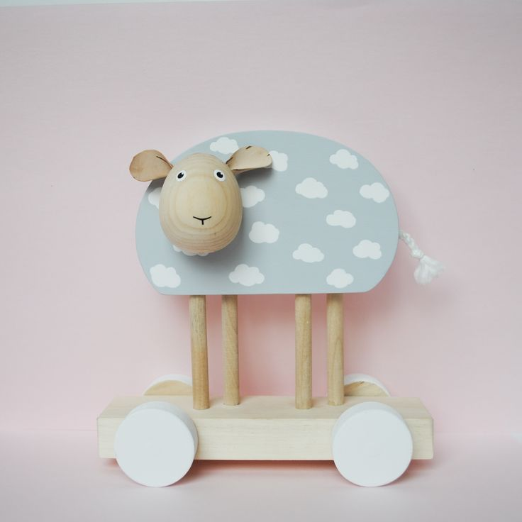 Wooden sheep. Stylish toy for kids.