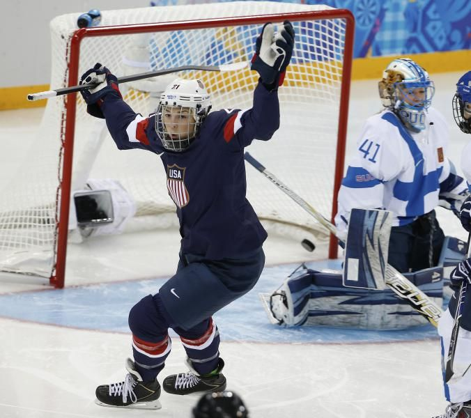 Hilary Knight of the Untied States celebrates her goal as Goalkeeper Noora Raty of Finland looks on during the women's ice hockey game at th...