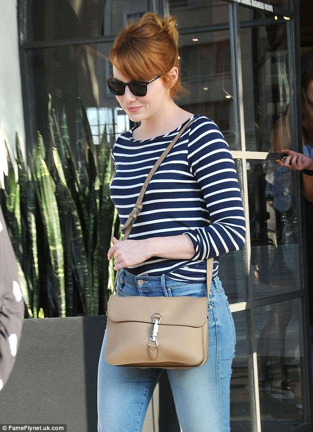 Back to red! Emma Stone was pictured leaving Meche Salon in Beverly Hills on Wednesday showing off freshly dyed locks