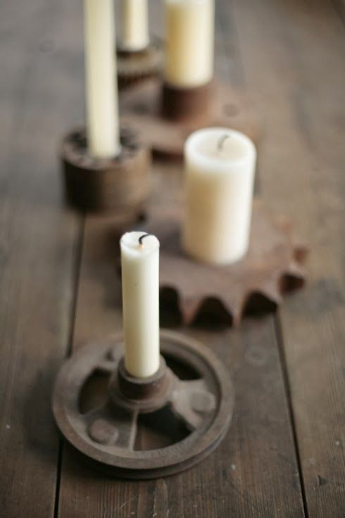 Old gears as industrial candle holders. Very Steam Punk! #industrialwedding My Big Day Events, Colorado Parties, Wedding, Planning & More! http://www.mybigdaycompany.com/