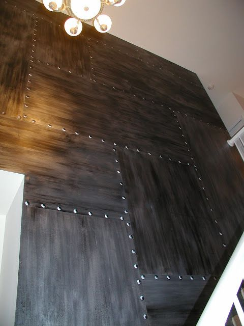 An effect like this could be achieved with plywood panels and faux rivets (domed wood plugs), and we could paint it the same color as your adjacent walls or something more industrial. Description from pinterest.com. I searched for this on bing.com/images