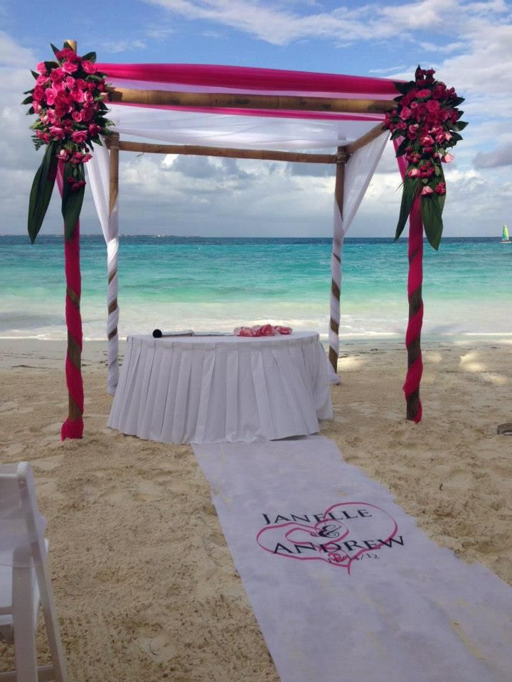 Beach wedding chuppah at Riu Palace Las Americas in Cancun, Mexico with customized ceremony runner