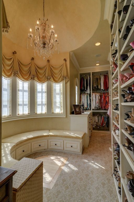 walk in closet with a window and a shoe wall!!!!! Would be cool as a dining room bench for table.