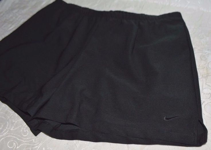 """Stay stylish with the newest women's NIKE Tennis shorts. Shorts Underneath. Measurements: Length: 14"""". Waist across(laid flat): approximated 16"""".   eBay!"""