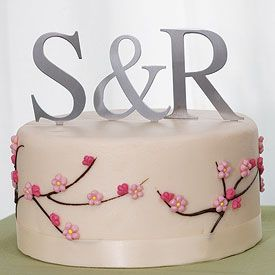 3-inch tall silver monogram cake toppers. Might be cute for the side of the cake somewhere.. R & W
