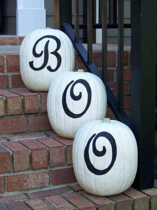 Boo Pumpkins -- painted white with black lettering.