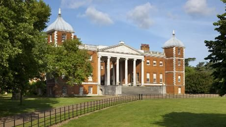 The impressive entranceway to Osterley Park with its neo-Grecian facade. Cows, swans and marble courts. Volunteers run a second-hand bookshop. North from Hampton Wick, in bicycle distance. National Trust.