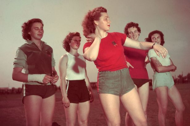 Thrown together: Female shot put athletes mingle in training. Amazing Colour Photos of the 1948 London Olympics