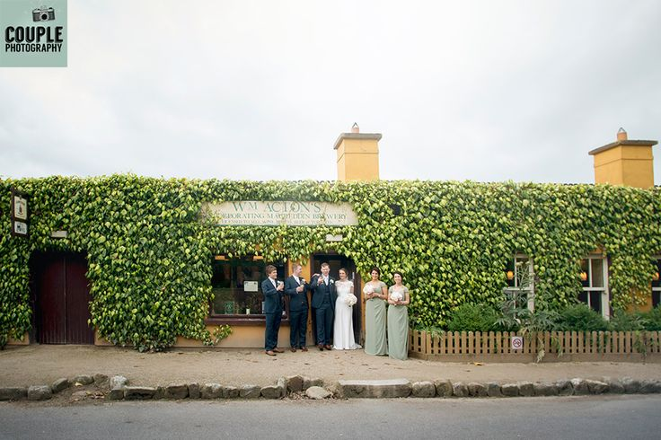 The Bridalparty outside the bar surrounded by ivy. Wedding photography at The Brooklodge Hotel by Couple Photography.