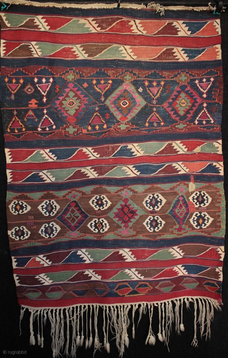 Small circa 3rd quarter 19th century Anatolian kilim from Malatya, probably Sinan village or one of the surrounding villages now also under the Karakaya dam. The top fringe plaited in Kurdish style  ...