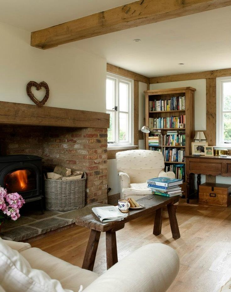 so lovely with all that lovely timber, the white couch and armchair, timber floor.......